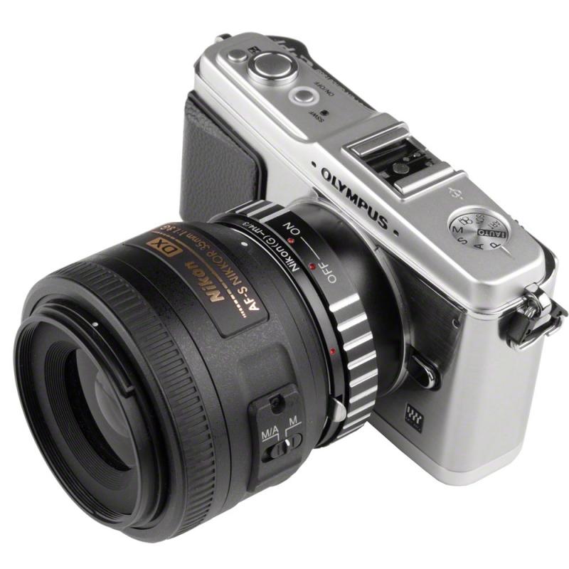 Kamera mirrorless dengan lensa DSLR